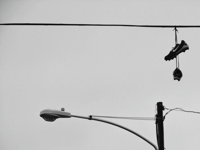 Cable Electricity  No People Outdoors Blackandwhite Photography Black & White Black And White Photography Blackandwhite Black And White Black&white Blackandwhitephotography Sneakers Trainers Power Line  Utility Pole Street Light Streetlights Streetlight Streetlamp Laces Cleats