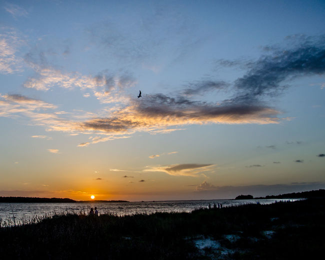 Clouds At Sunset EyeEM Beach Photography EyeEm Best Shots Flying Pelican People People Watching Sunset Romantic Landscape SeabrookIsland,SC Silouette Sky And Clouds South Carolina Sunset #sun #clouds #skylovers #sky #nature #beautifulinnature #naturalbeauty #photography #landscape Sunset At The Beach Sunset Silhouettes Tranquil Scene