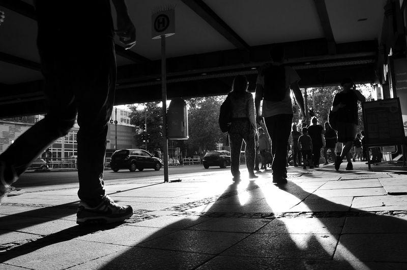 Silhouette people walking on street
