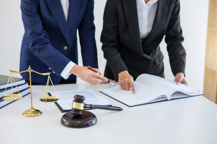 Lawyer Balance Barrister Business Business Person Businessman Cooperation Corporate Business Counselor Fairness Gavel Holding Indoors  Inheritance Judge Judgement Legal Occupation Office Paper Paperwork People Suit Teamwork Verdict