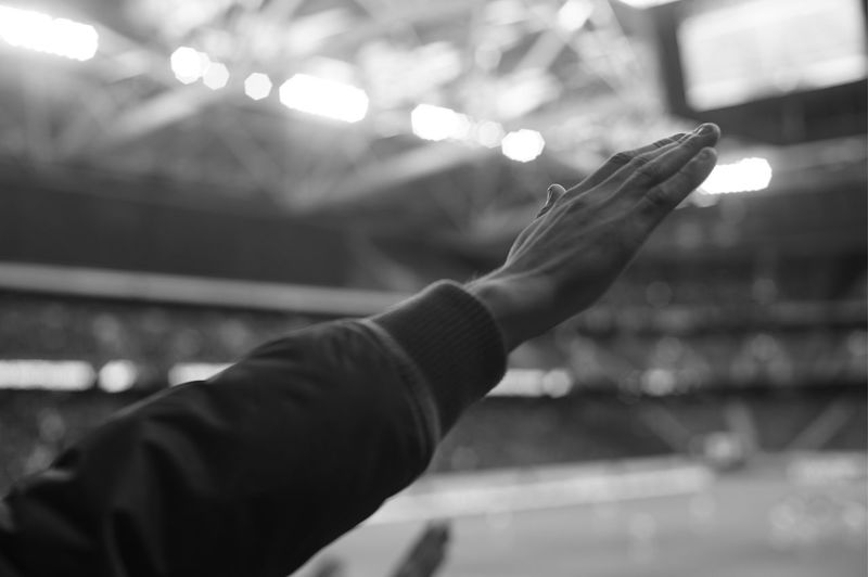 The hand. Salute. Fotball Fever Illuminated Focus On Foreground Night Real People One Person