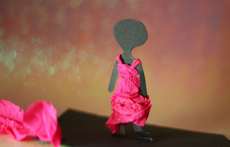 Close-up of girl standing on pink flower