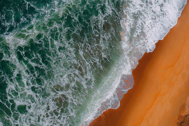 aerial view of sea waves water texture background Sea Motion Wave Water Beauty In Nature No People Sport Aquatic Sport Nature Land Beach Power In Nature Scenics - Nature Rock Power Close-up Outdoors Non-urban Scene Breaking