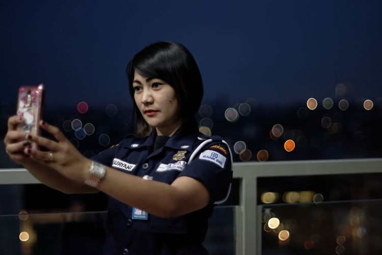 Security officer taking selfie at night