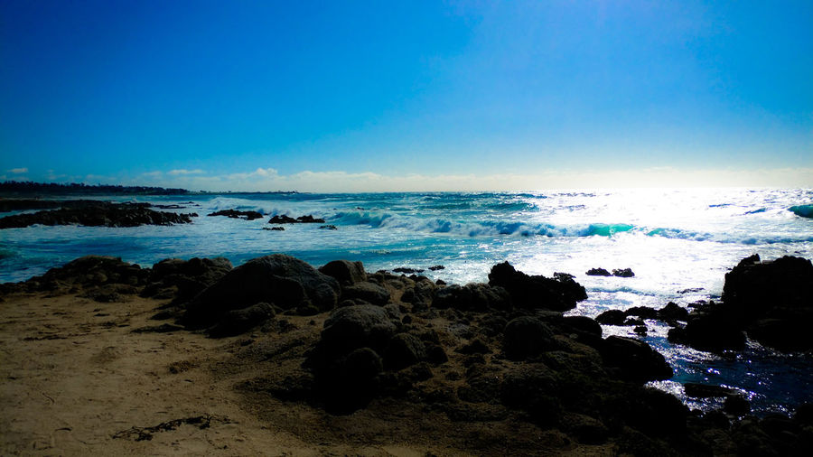 Sea Land Sky Water Beach Horizon Over Water Nature Scenics - Nature Horizon Blue Beauty In Nature No People Tranquility Outdoors Wave Clear Sky Sand Rock
