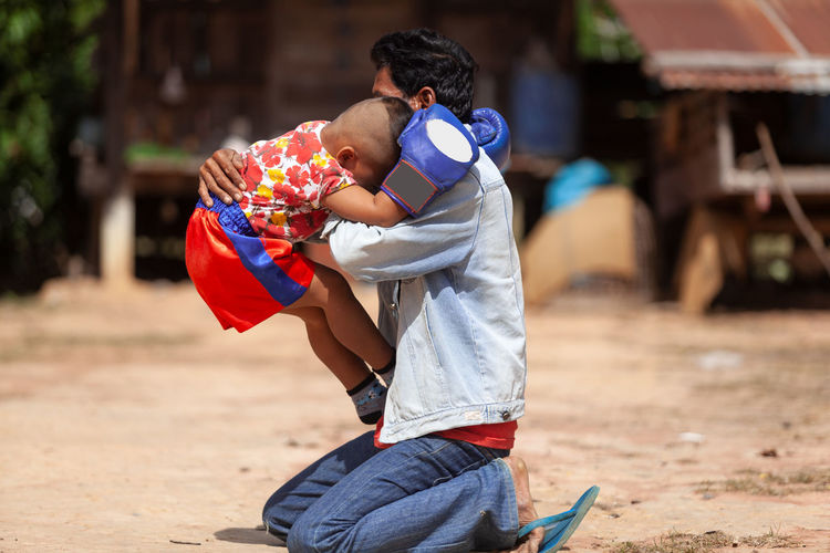 Togetherness Men Love Real People Bonding Males  Child Childhood Family Lifestyles Women Positive Emotion Leisure Activity Focus On Foreground Casual Clothing People Females Day Family With One Child Son Outdoors Innocence MuayThai Thai Boxing  Training