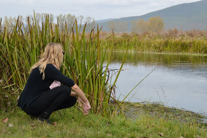Full Length Grass Growth Nature One Person Outdoors People Person River Squat Water Woman Young Adult Long Goodbye