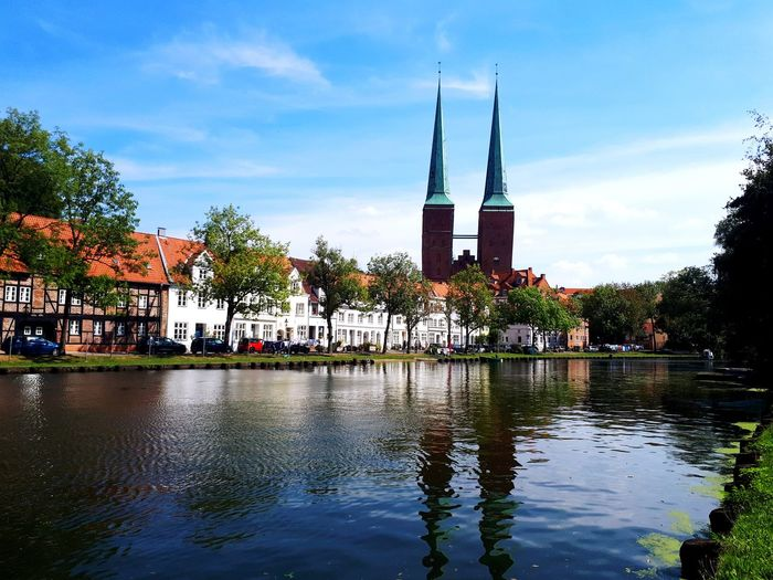 Church reflection Lübeck Canalview Canal Lübeck Sonnig Blue Sky Church Tower Old Buildings ARTfoxHH Sunny Water Cityscape Waterscape City Water Tree Reflection Flood Sky Architecture Cloud - Sky Postcard Waterfront