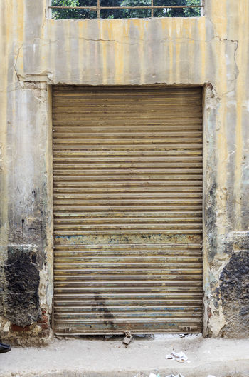 Architecture Architecture Built Structure Close-up Closed Closed Door Corregated Steel D Day Deterioration Door No People Old Old Buildings Old-fashioned Outdoors Run-down Rusted Rusted Metal  Rusty Safety Security Weathered Wood - Material Wooden