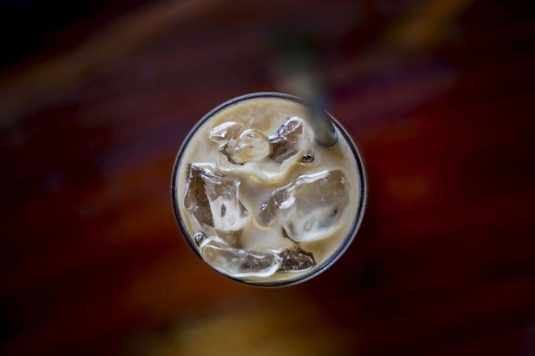 High angle view of ice tea on table