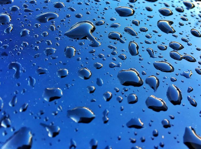 Water Rain Drop Blue Metal Many Backgrounds Textured  Wet Full Frame Close-up No People RainDrop Transparent Glass - Material Window Nature Rainy Season Indoors  Day Glass Purity