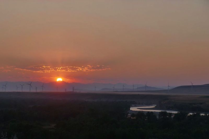 Sundown over the Oldman River. Sunset Beauty In Nature No People Landscape Wind Turbine Wind Power River Water Reflections Solar Sun Renewable Renewable Energy Renewable Energy Wind Turbine Sky Scenics Tranquil Scene