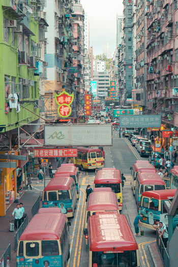 Traffic on city street amidst buildings