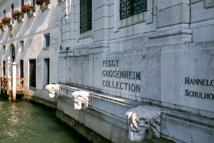 Guggenheim Museum Peggy Guggenheim Collection Architecture Building Exterior Built Structure Water Text No People Day City Animal Transportation Representation Communication Animal Themes Mammal Canal Western Script Wall - Building Feature Art And Craft Building