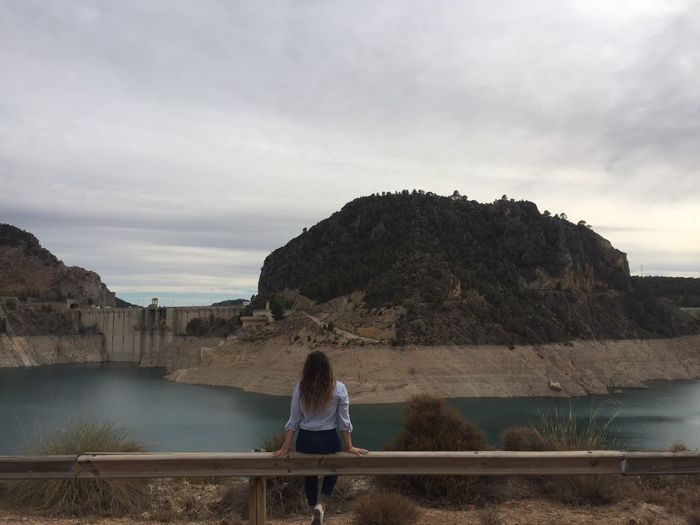 Paradaise❤️ Rear View Standing Leisure Activity Mountain Water Sky Lifestyles Tranquil Scene Tranquility Scenics Person IPhone IPhoneography Iphoneonly Cloud - Sky Beauty In Nature Lake Railing Getting Away From It All Casual Clothing Day Loneliness Nofilter Noedit