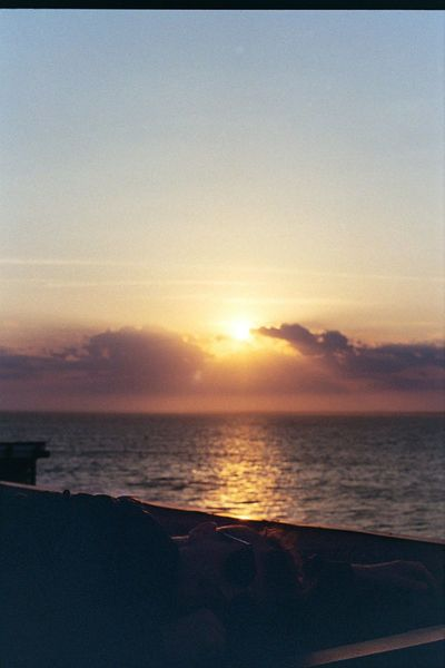 Lay on the roof while the sun sets. Sunset Sea Beach Sun Scenics Tourism Beauty In Nature Water Vacations Travel Destinations Outdoors Tranquil Scene Horizon Over Water Fireisland Fire Island 35mm Film 35mm Film Photography Film The Week On EyeEm Lost In The Landscape