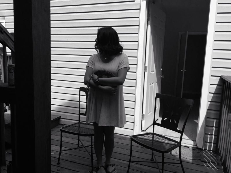 People And Places Black And White Photography Young Women Young Adult Outdoors White Dress Thinking About Life Patio Chairs Open Door Light And Shadow Monochrome Photography Women Around The World The Secret Spaces The Portraitist