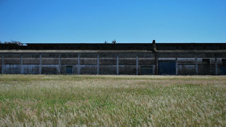 Clear Sky Blue Copy Space Built Structure Building Exterior Grass Field Day Outdoors No People EyeEm Gallery EyeEmBestPics EyeEm Best Shots Abandoned Places Space Grassy Blue Sky Bluesky Graphic City Exploration City Explore City Explorer Popular Photos Popular TakeoverContrast