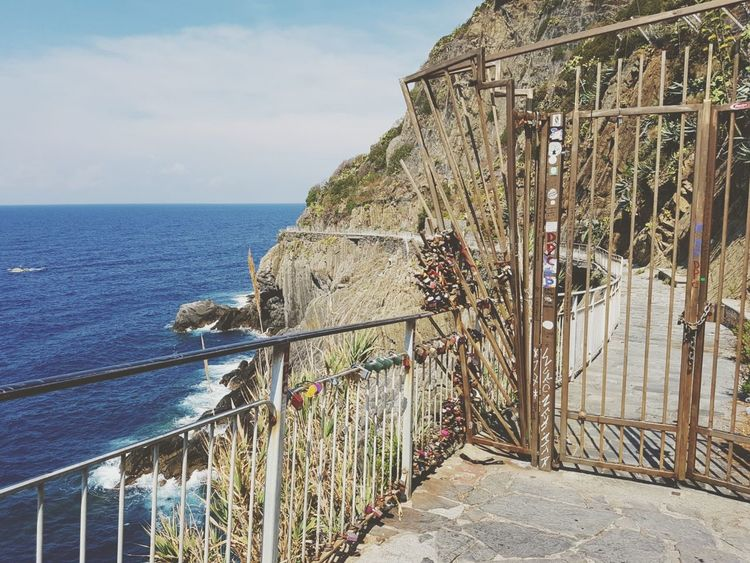 Sea Water Railing Outdoors Day Horizon Over Water Nature Tranquility Sky No People Beauty In Nature Nautical Vessel Architecture Gate Gateway To Heaven Closed Door Closed Road Forbidden Places Do Not Enter No Way Through Cliffs Italy Cinque Terre Romantic Walk EyeEm Best Shots Breathing Space Investing In Quality Of Life The Week On EyeEm