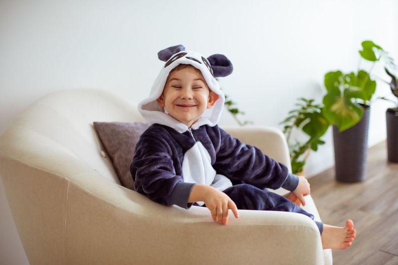 Portrait of smiling boy sitting