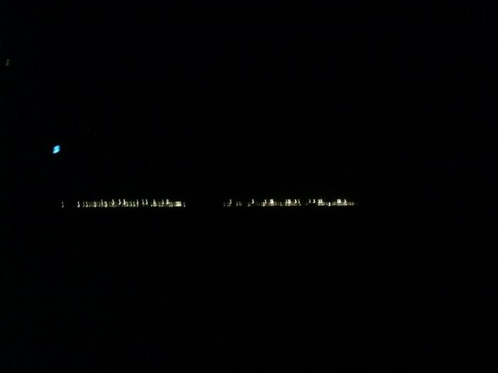 These lights off in the distance are a prison. And no kidding, there is actually a rest stop at this exit with signs warning people not to pick up hitchhikers.