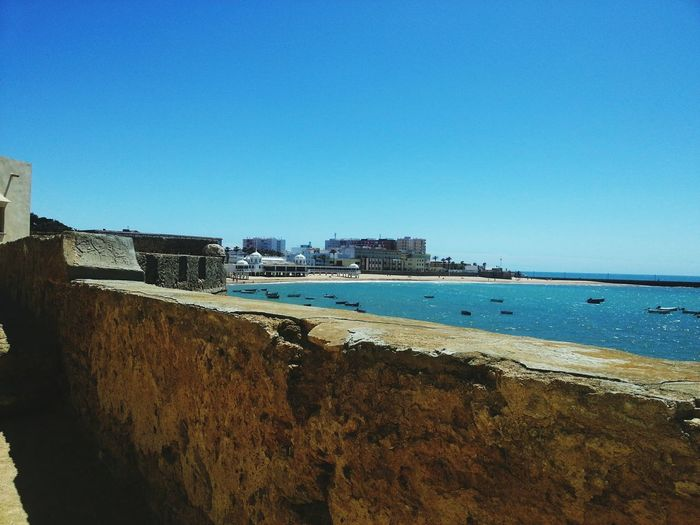 Cádiz, Spain Beauty In Nature Close-up Beachphotography Beach Antique Building Architecture See Sky Summer Outdoors Photoshoot