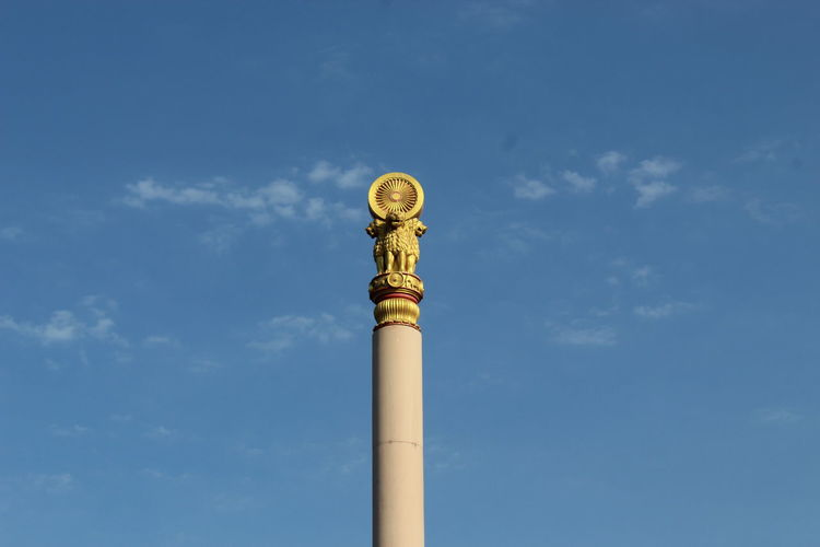 Low angle view of architectural column against blue sky