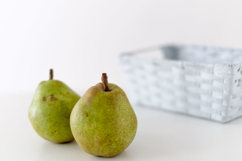 Two pears Food Still Life Fruit Food And Drink Indoors  Cut Out Pear Freshness Close-up White Background Ripe Healthy Eating No People Wellbeing Green Color Studio Shot Copy Space Focus On Foreground Group Of Objects Three Objects Apple - Fruit Hatamoto Shinichi