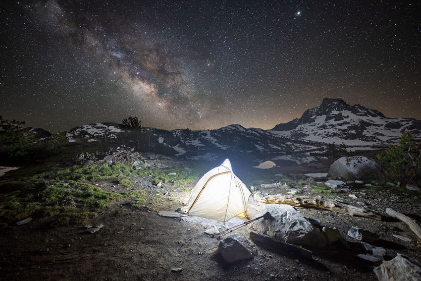 Tranquility of wilderness | One of the shots I always attempt to take while in the wilderness is a campsite under thousands of stars. And what better opportunity is there with the Milky Way and Mt. Ritter as a backdrop when there was so much openness to it? I was able to frame the shot with Jupiter still lingering above the snow clad, 15th highest peak in California. The wind almost calmed down, and I just simply took my time bracketing the shots. Tranquility of wilderness was set in with a distant echo of frogs singing under the countless stars. Thousand Island Lake, CA Ansel Adams Wilderness Jupiter Mt. Ritter Thousand Island Lake Adventure Astronomy Beauty In Nature Camping Long Exposure Milky Way Mountain Nature Night No People Non-urban Scene Outdoors Scenics - Nature Sky Snowcapped Mountain Space Star Star - Space Tent Tranquil Scene Tranquility
