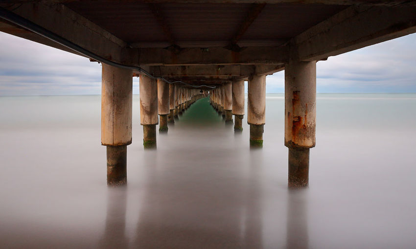Reflection of pier on sea