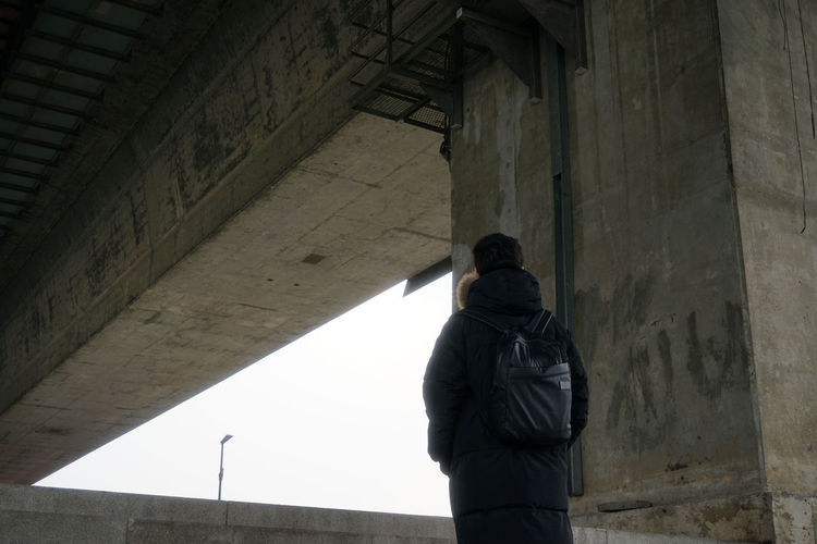 Rear view of man standing in city