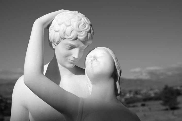 Forest Lawn Archival Women Two People Adult Gray Background Adults Only Men People Human Body Part Togetherness Outdoors Day Fujifilm_xseries Focus On Foreground Lowkeyphotography Architecture Depression - Sadness Straightfromcamera Light And Shadow Blackandwhite Low Angle View Blue Skies Statue Headshot Heart Shape