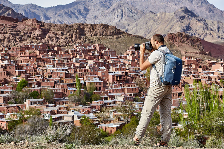 Full length of photographer photographing buildings