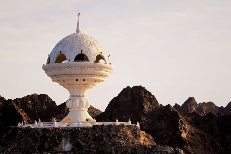 Muscat muttrah oman incense burner on hill against mountains