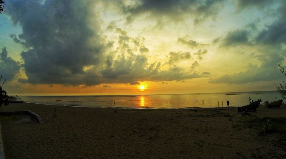 Sky Water Beach Sea Land Cloud - Sky Sunset Beauty In Nature Scenics - Nature Horizon Over Water Horizon Tranquil Scene Tranquility Outdoors Nature Sand Idyllic Sunlight Incidental People A New Beginning