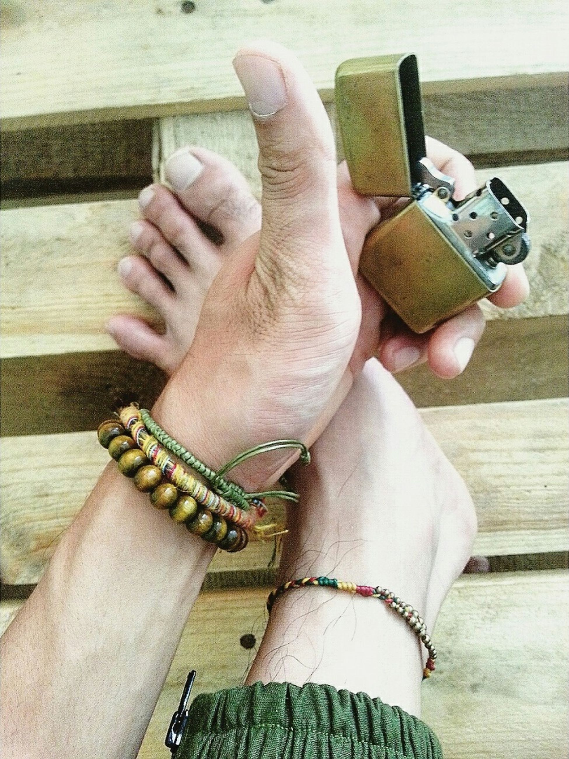 person, part of, cropped, human finger, holding, indoors, high angle view, personal perspective, lifestyles, unrecognizable person, close-up, leisure activity, ring, men, focus on foreground, wood - material