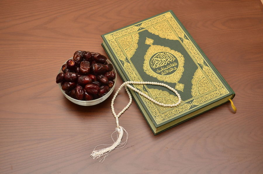 The Holy Quran. It is the sacred book for all Muslims, which contains message from Allah, regarding living the life on this earth. Aftari Allah AllahuAkbar Dates Eid Furqan Iftar Indoors  Islam Koran Medina Mekkah Mohammad MUHAMMAD Muslim Muslimah No People Palm Tree Quran Ramadan  Religion Sunnah Tasbih Ummah Wooden