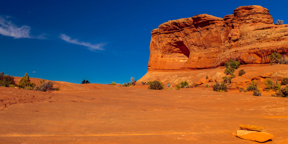 Arches National Park Copy Space Delicate Arch Hike Evening Light Hiking Trail Landscape Physical Geography Red Sandstone Rock Formation Summer Tourism Travel Destinations Unrecognizable Person Utah