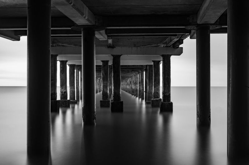 Underneath view of pier over sea