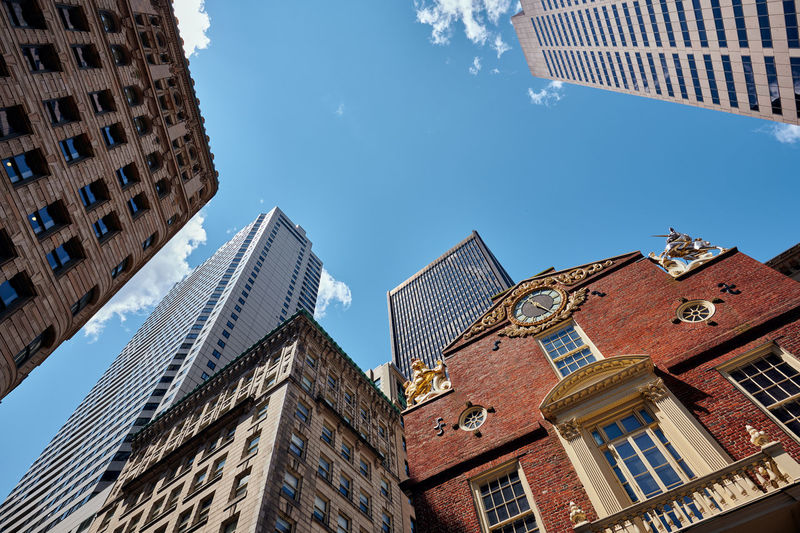 Low angle view of boston old state house against clear blue sky