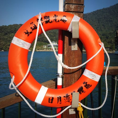Life Belt Orange Color No People Day Nautical Vessel Buoy Text Outdoors Close-up Water Nature 日月潭 Sun Moon Lake Travel Taiwan Sunlight Beach