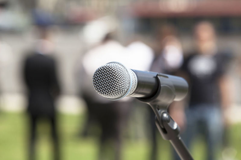 Microphone in focus against blurred people Close-up Day Event Horizobtal Microphone Microphones Miting Outdoors People People Watching Press Conference Room Public Speaker Public Transportation Recording Sound Speaker Technology