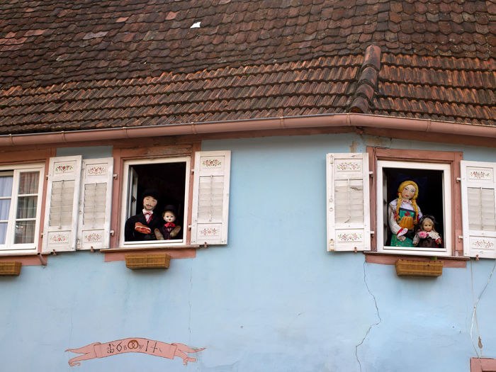 Old house facade in Wissembourg/France Alsace France Alsace-Lorraine Blind Blinds Blue Cities City Doll Dolls France House Facade House Facades House Wall Puppet Puppets Shutter Shutters Tourist Destination Town Towns Travel Destinations Vosges Weathered Window Windows