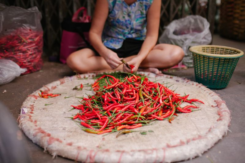Low Section Of Vendor With Red Chili Pepper At Market