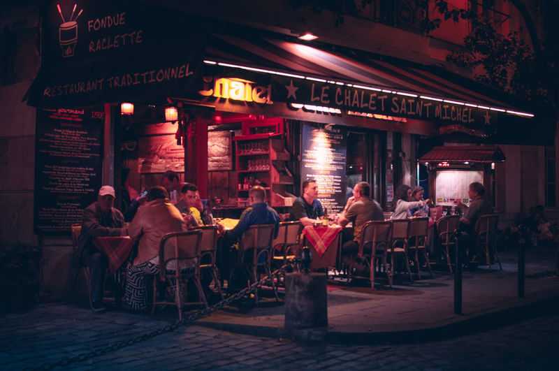 People in restaurant at night