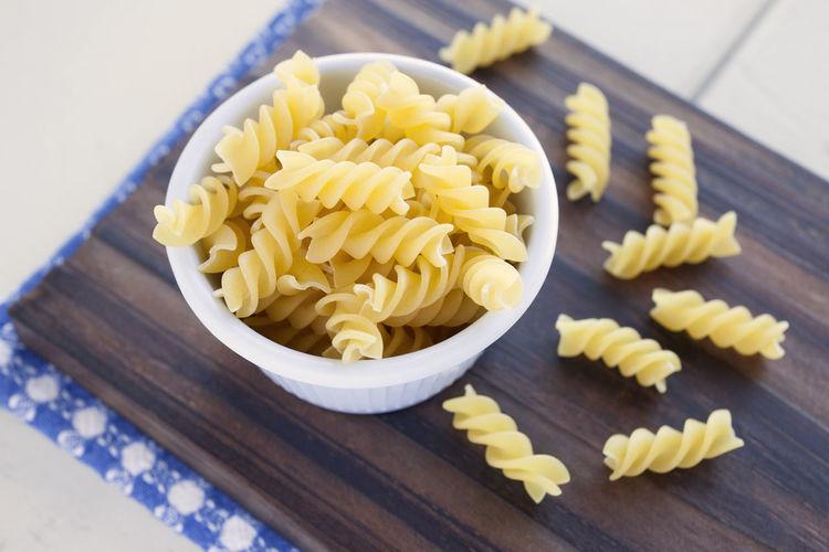 Dried Fussilli pasta Close-up Day Food Food And Drink Freshness Fuchile Fusili Fusilli Fussilli Indoors  Italian Food No People Pasta Raw Food Refusil Table Wood - Material Yellow