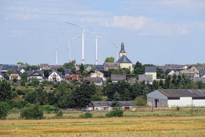 Cityscape of Moersdorf in Rhineland-Palatinate, Germany. Village is known for the simple suspension bridge Geierlay. Wind turbine. Mörsdorf Alternative Energy Built Structure Field Geierlay Hunsrück Industrial Windmill Landscape Nature Renewable Energy Rural Scene Traditional Windmill Wind Power Wind Turbine