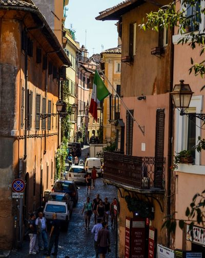 Italy Flag Tourist Travel Building Exterior Built Structure City Day Flag Large Group Of People Old Houses Outdoors People Real People Residential Building Street Tourism Trastevere