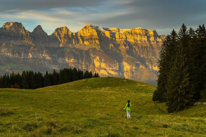 Nature One Person Grass Mountain Beauty In Nature Sky Real People Tree Scenics Leisure Activity Full Length Standing Cloud - Sky Landscape Tranquility Day Outdoors Lifestyles Mountain Range Switzerland Flumserberg SONY A7ii