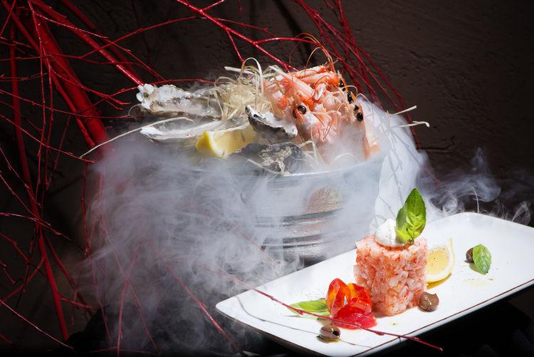 Seafood platter serve with liquid nitrogen special effect